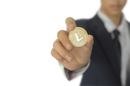 LTC cion (Litecoin) in the hands of the businessman.   Isolate on a white background.