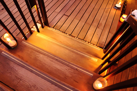 stair: Candles on wood stair. Stock Photo