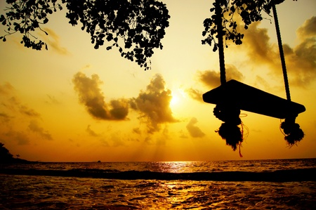 silhouette swing on the beach