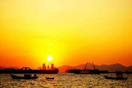 Fishing boat in the sunrise time Stock Photo