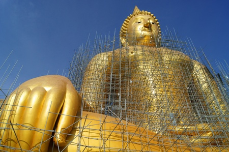 Golden Buddha Statue Under Construction             Stock Photo