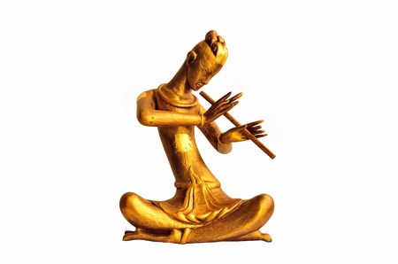 Thai Style Musician Wood Carved Playing flute photo