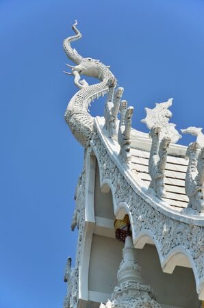 The Gable Apex Of Temple On Blue Sky Background photo