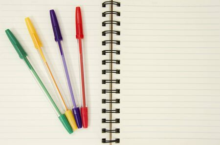 Notebook and colorful pens photo