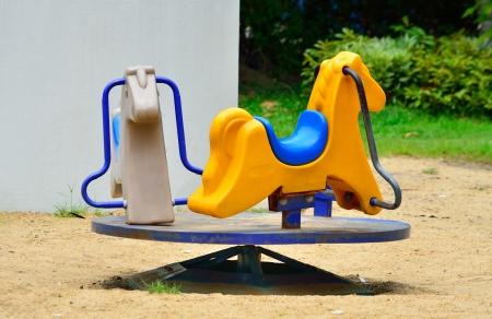 Carousel In Playground Stockfoto