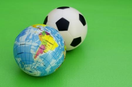 Globe and Soccer Ball Stock Photo