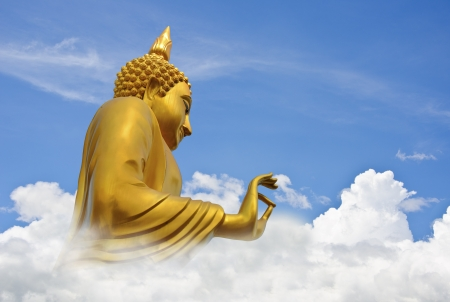 Golden Buddha In Blue Sky Stock Photo