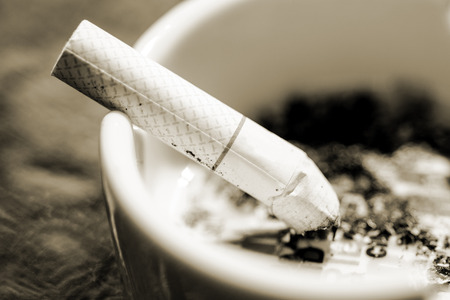Cigarette   Ashtray in Sepia Tone