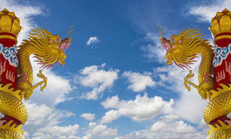 Golden Dragon Statues With Blue Sky