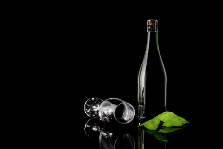 Green Wine Bottle and Wine Glass Stock Photo