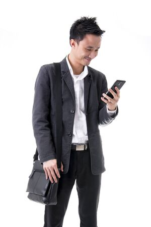 Young Asian Employee Smiling While Reading Good Message