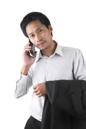 Young Asian Businessman Talking On Mobile Phone