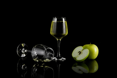 Glass of Apple Wine On Black