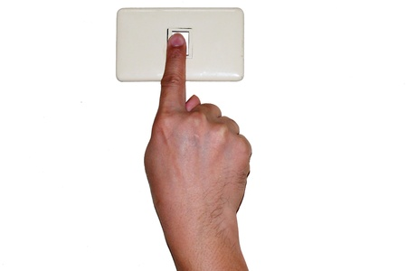 Finger off the light switch for saving the energy  Stock Photo