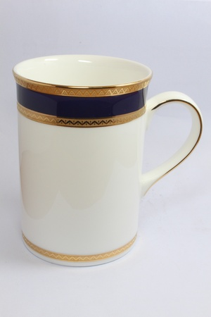 White  coffee cup with golden stripes
