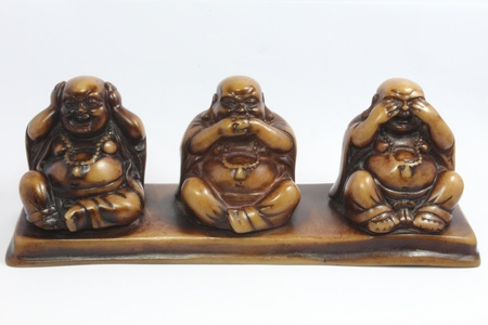 Wood carvings Buddha close your eyes, ears, mouth Stock Photo