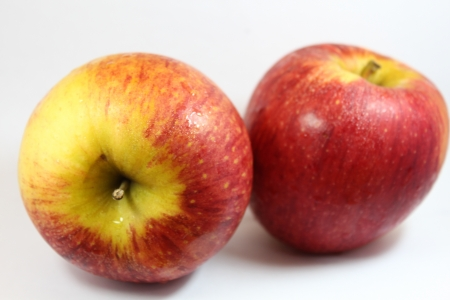 doublet:  Two Red Apples  on white blackground