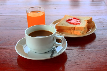 Set bread and coffee  on wooden  table