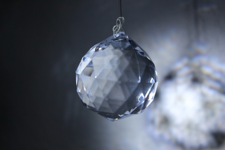 The light shine from the white crystal over black background Stock Photo - 22709571
