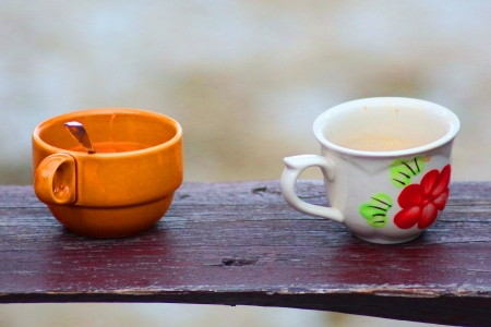 two cups of coffee on wooden table at the seaside resort Stock Photo