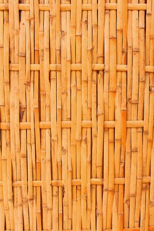 Wall from the tied up bamboo planks