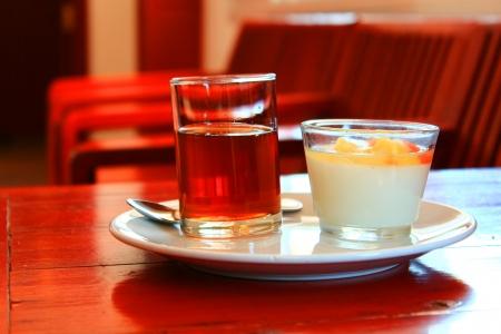 Tao huai  fruit salad  and hot tea on redwood table