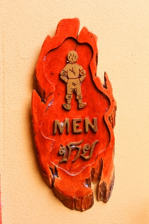 Man wooden carving vintage sign in Thai language Stock Photo