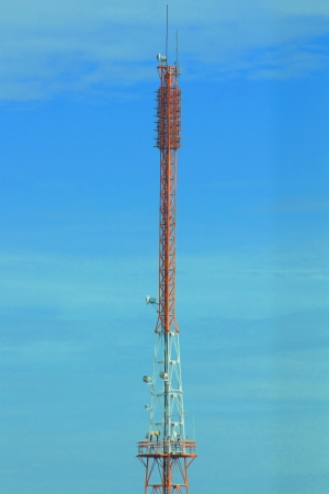Tower of communications with antennas in the middle of sky Stock Photo