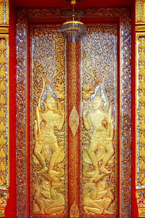 Chapel door carved gold  at  Nontaburi ,Thailand  Stock Photo