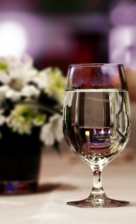 Glass of wine  for dinner on  purple background
