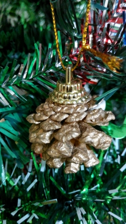 Golden cone pine decorated on Christmas Tree