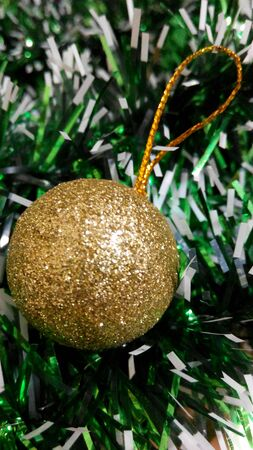 Golden Ball Decorated on Christmas Tree Stock Photo