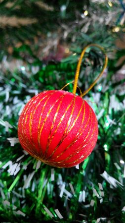 Red Ball Decorated on Christmas Tree Stock Photo