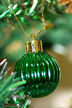 Green Ball Decorated on Christmas Tree Stock Photo