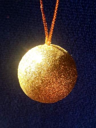 Golen Ball s Christmas Tree Decoration on Blue Background