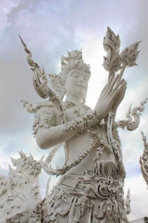 divinity: White angel statue at Wat Rong Khun ,Chiangrai Thailand Stock Photo
