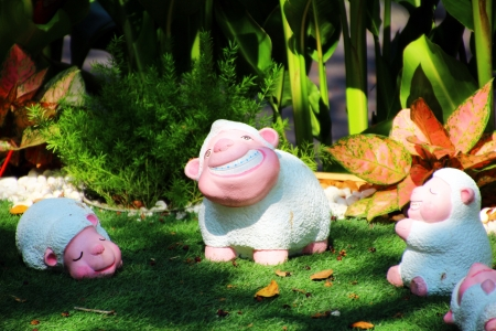 eyesclosed: Family lambs statues  in the garden  Stock Photo