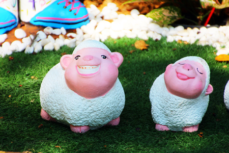 eyesclosed: lambs statues  in the garden  Stock Photo