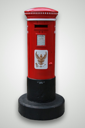 Red and vintage postbox on white background ,Isolate  photo