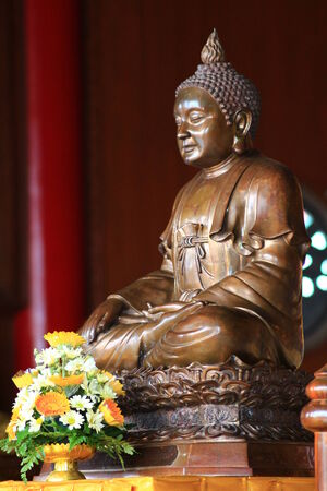 Solid  brass Buddha statue  on  wooden altar
