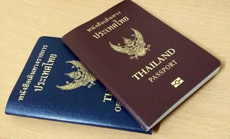 Thailand Passport on wooden table
