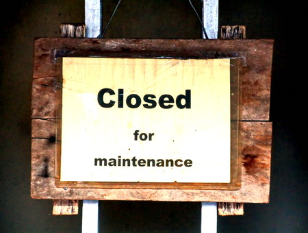 Signboard of closed for maintenance Stock Photo