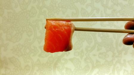 grip: Chopsticks  grip  fresh fish  meat Stock Photo