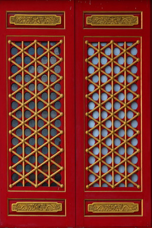 antiquated: Ancient wooden door with golden tracery