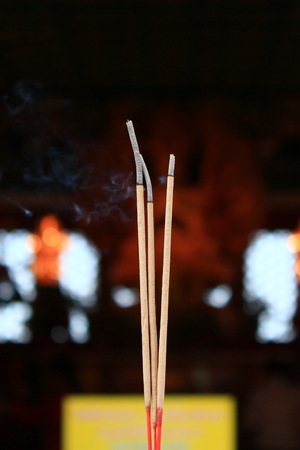 an obeisance: Incense in Thai temple