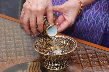 formality: Pour ceremonial water  with porcelain , Benjarong