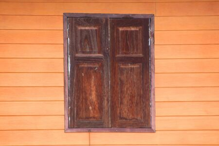 Ancient wood window on wooden wall