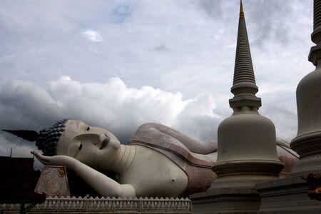 Reclining Buddha image behind stupa