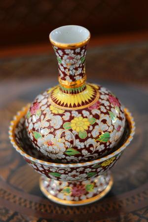 Porcelain pour water ceremonial benjarong Stock Photo