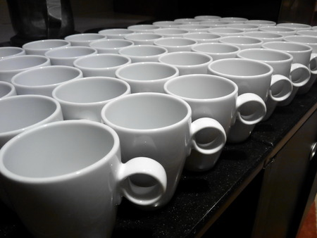 White coffee cups in  rows Stock Photo